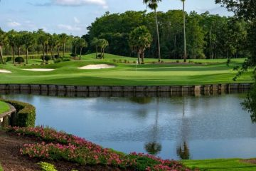 The commercial landscaping brings this community golf course to life with bright pink blossoms and green foliage.