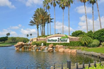 Mature landscaping products surround a community neighborhood entrance sign wall for Heritage Palms Golf and Country Club