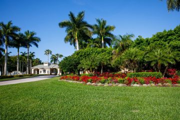 Large colorful planter adds a pop of color to the entrance of a Southwest Florida country club and golf course.