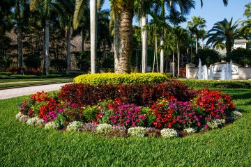 This large planter bed includes yellow, red, pink, purple and white flowers at a Southwest Florida golf country club.